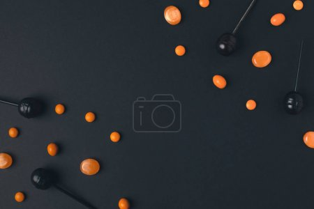 Photo for Close-up view of black and orange halloween lollipops on black - Royalty Free Image
