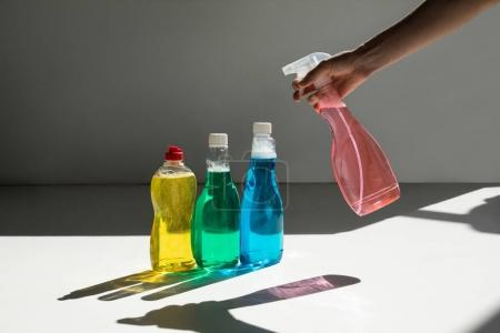 human hand and cleaning fluids