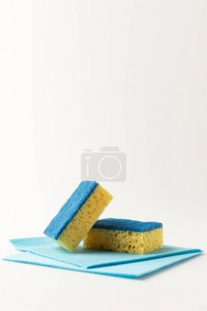 Photo for Close-up view of sponges and rags for cleaning isolated on white - Royalty Free Image
