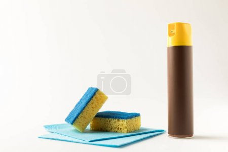 Photo for Close-up view of cleaning product, rags and sponges isolated on white - Royalty Free Image