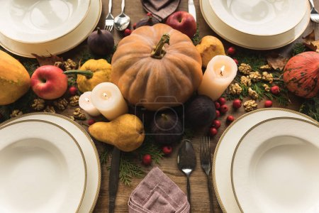Photo for Close-up view of beautiful autumn decor and cutlery on table served for thanksgiving dinner - Royalty Free Image