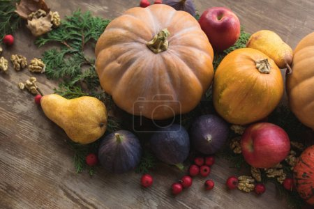 Photo for Top view of ripe seasonal fruits and vegetables on wooden table - Royalty Free Image