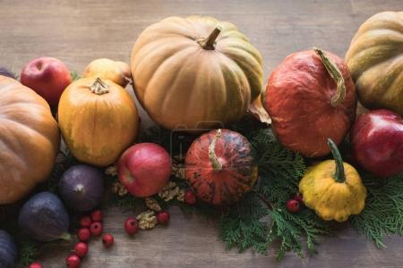 Photo for Top view of ripe autumn fruits and vegetables on rustic wooden table - Royalty Free Image