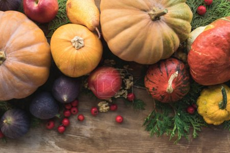 pumpkins and fruits on table