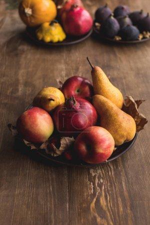 ripe autumn fruits on table