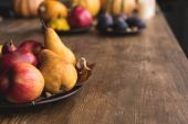 ripe autumn fruits on table