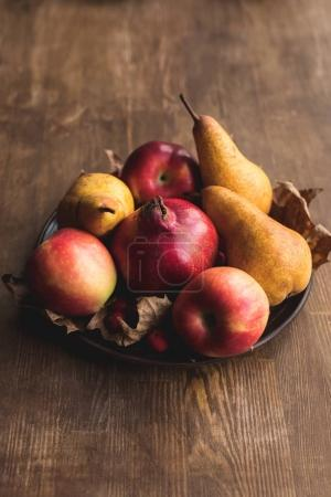 Photo for Close-up view of ripe fresh healthy autumn fruits on plate - Royalty Free Image