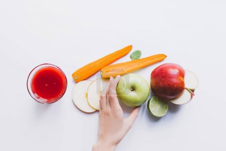 human hand and smoothie with ingredients