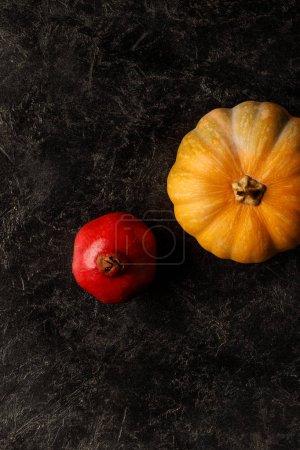 Autumnal pomegranate and pumpkin