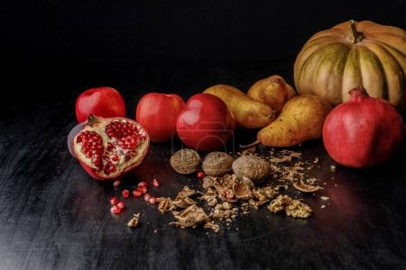 Photo for Still life with organic pumpkin, fruits and walnuts on wooden table - Royalty Free Image