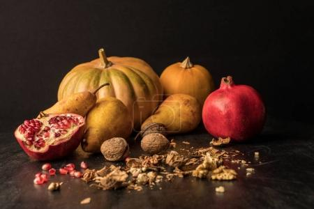 Photo for Still life with organic pumpkins, fruits and walnuts on wooden table - Royalty Free Image