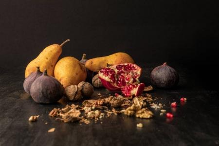 Photo for Still life with organic autumnal fruits on wooden table - Royalty Free Image
