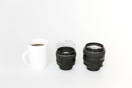 lenses and coffee mug