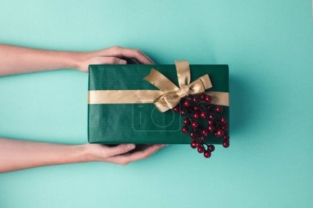 Hands holding christmas gift