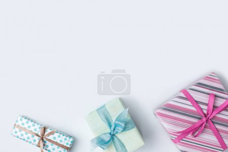 Photo for Flat lay with arrangement of various colorful presents isolated on white - Royalty Free Image
