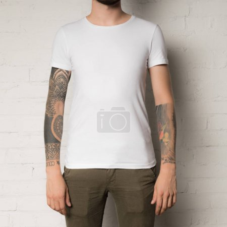 Photo for Cropped shot of man in blank white t-shirt - Royalty Free Image