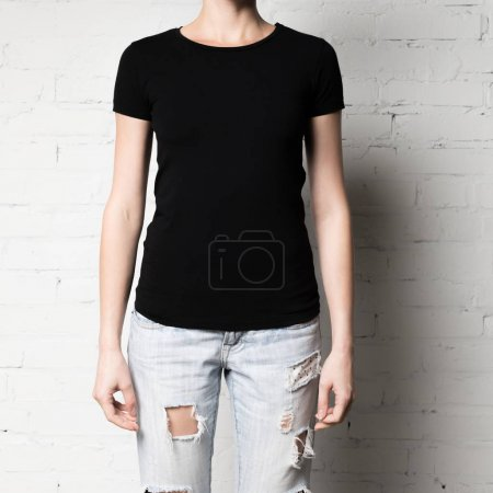 Photo for Cropped shot of woman in blank black t-shirt - Royalty Free Image