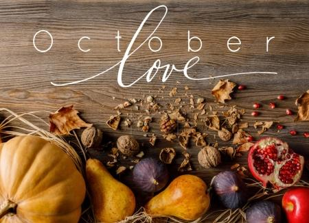 Photo for Top view of pumpkin, seasonal fruits and walnuts on wooden tabletop - Royalty Free Image