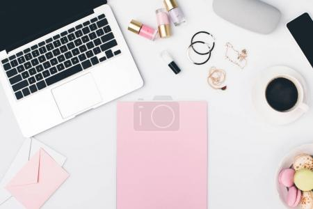 Photo for Top view of modern workplace with laptop and blank pink papers - Royalty Free Image