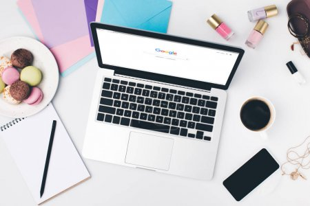 Photo for Top view of laptop with google website at modern girly workplace - Royalty Free Image
