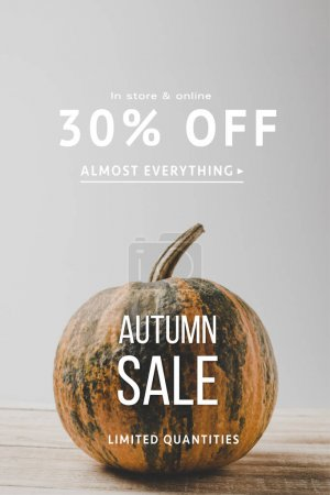 Photo for Close up view of raw pumpkin on wooden surface, autumn sale concept - Royalty Free Image