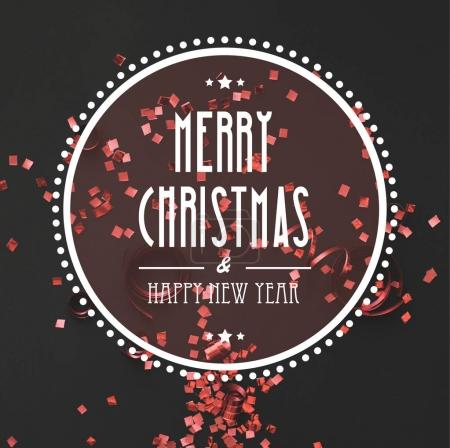 Photo for Christmas greeting in round frame with red confetti on black background - Royalty Free Image