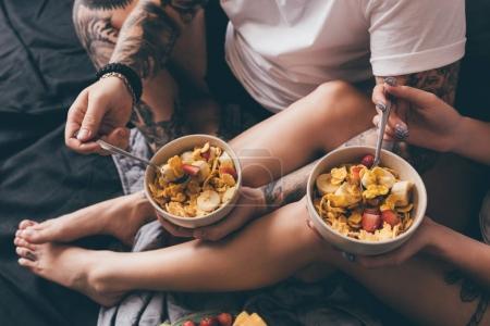 couple having healthy breakfast in bed
