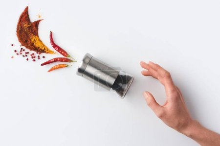 Woman reaching for pepper grinder
