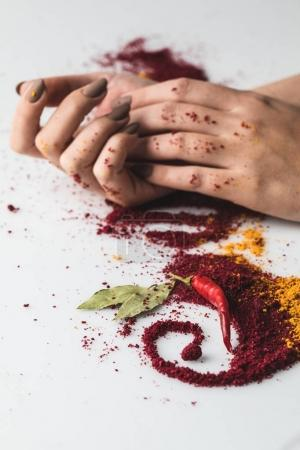 woman with various spices composition