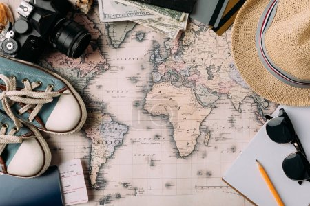 Photo for Top view of stuff for travel on a map. holidays concept - Royalty Free Image