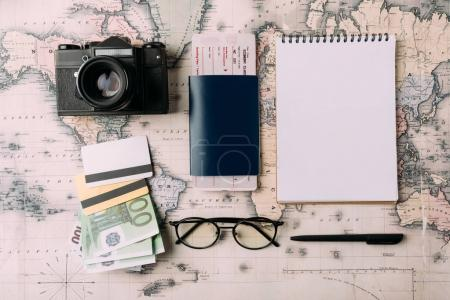 Photo for Flat lay of passport with ticket and money with credit cards on a map. tourism concept - Royalty Free Image