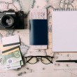 Flat lay of passport with ticket and money with cr...