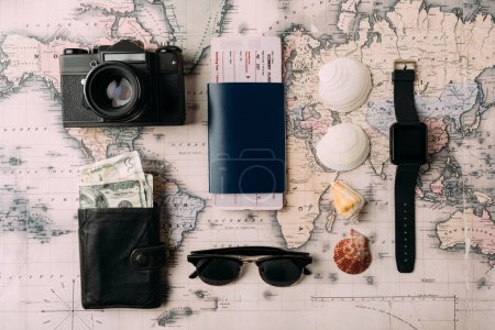 passport with ticket and money on map