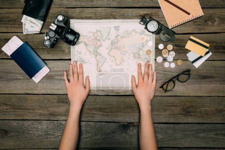 woman hands on map