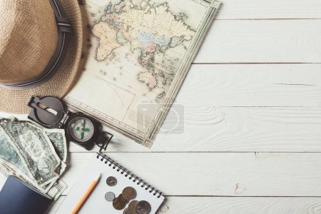 Photo for Top view of travel stuff on a white wooden table. Journey concept - Royalty Free Image