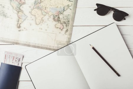 Map with notebook and pencil