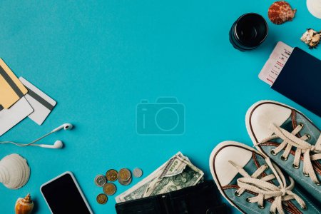 Photo for Top view of travel stuff on a turquoise surface - Royalty Free Image