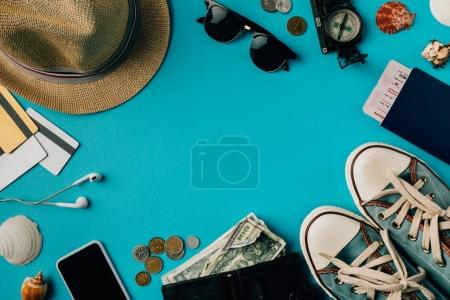 Photo for Top view money and passport with gumshoes on a turquoise surface - Royalty Free Image