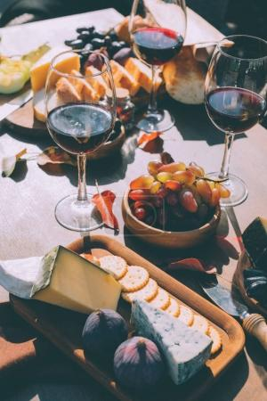 red wine with various snacks