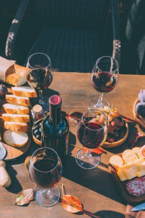 red wine and variation of snacks