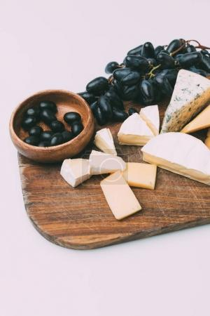 grapes and cheese on cutting board