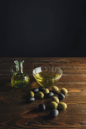 Glass bottle and bowl with olive oil