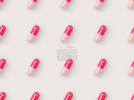 Photo for Set of red and pink pills isolated on white - Royalty Free Image
