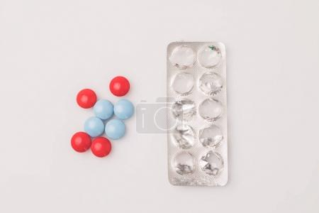 red and blue pills and blister pack
