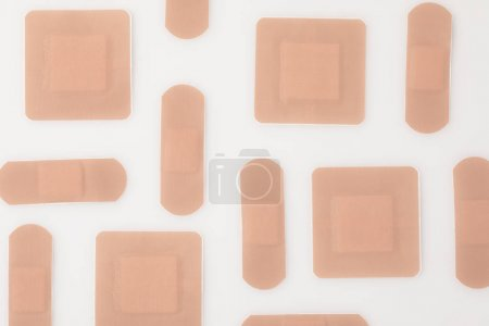 Photo for Top view of set of beige patches isolated on white - Royalty Free Image