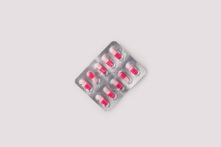 blister pack with red and pink pills