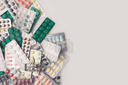 pile of blister packs with pills