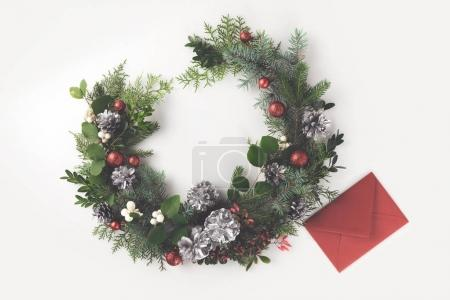 christmas wreath and red envelope