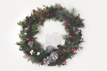 christmas wreath with balls and pine cones