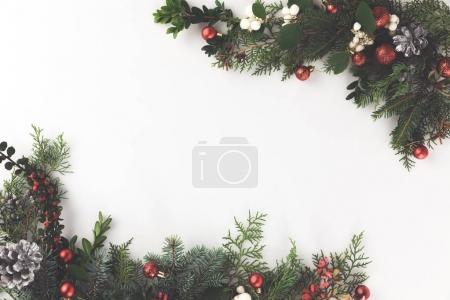 Photo for Top view of christmas frame made of fir branches, christmas balls and pine cones, isolated on white - Royalty Free Image